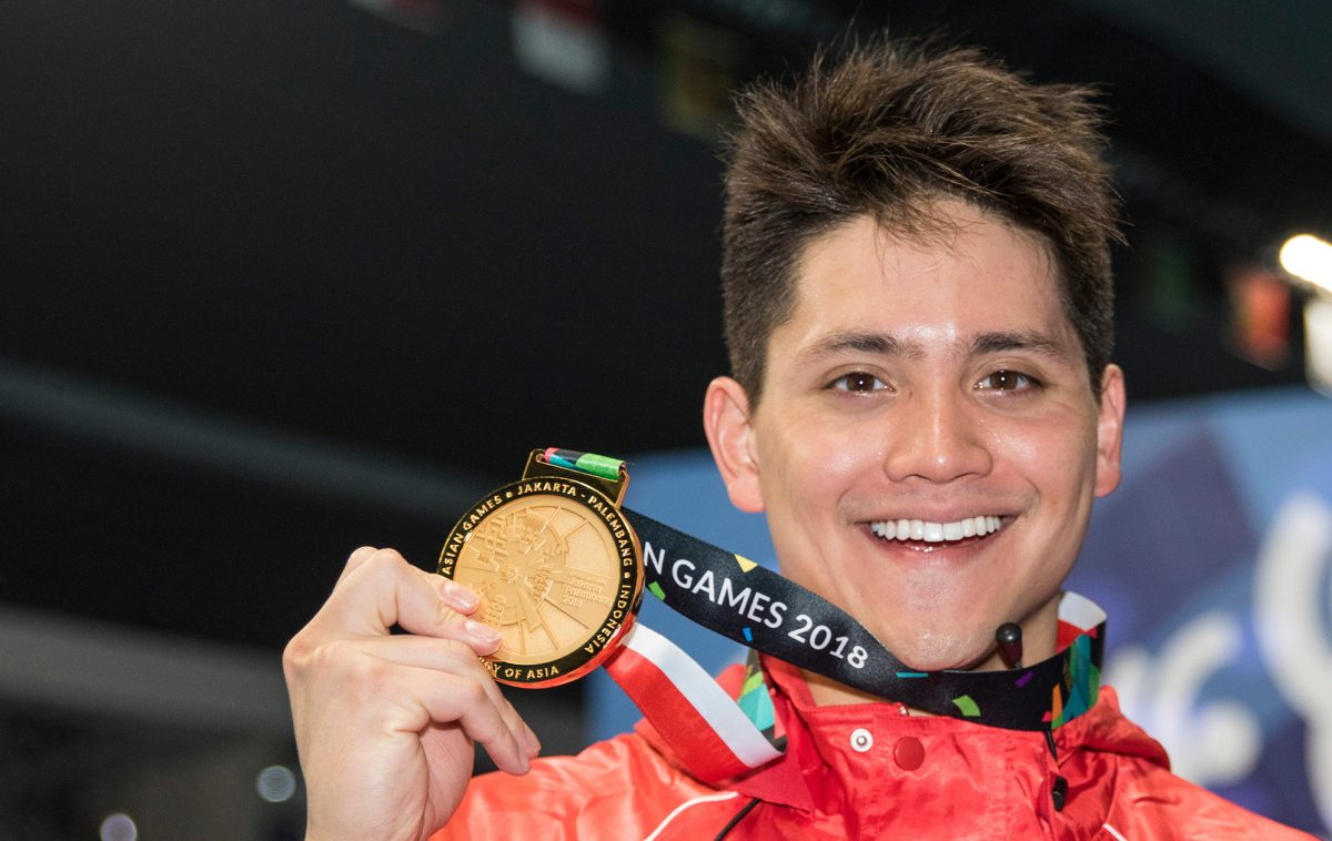 Joseph Schooling with his gold medal from the 2018 Asian Games. Photo: Simone Castrovillari